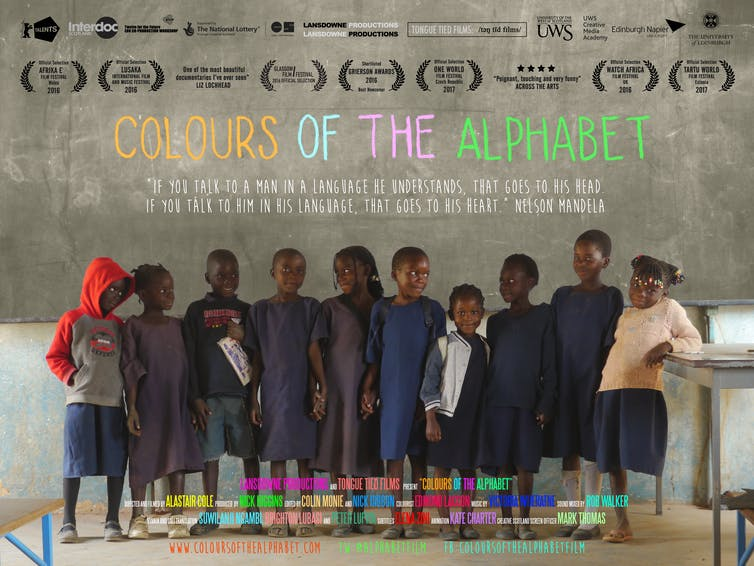 Film poster showing line of children in front of a blackboard.
