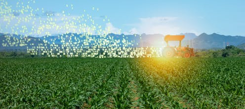 A tractor drives through a field kicking up data, instead of dust.