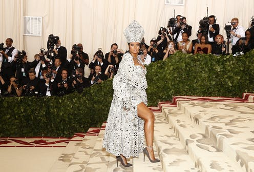 Rihanna on the Met Gala red carpet, dressed as a sexy pope.