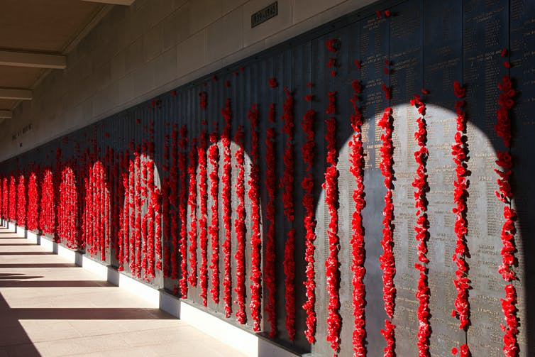 Hallway of the Australian War Memorial decorated with poppies.