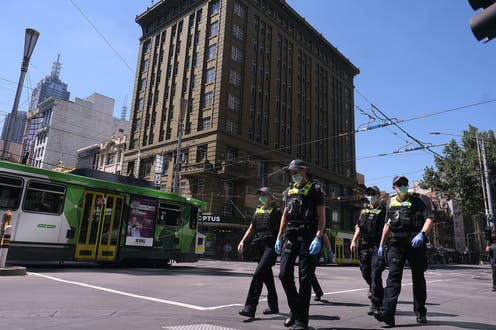 Victorian police officers walking in the streets of Melbourne