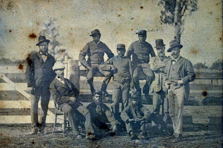 Photograph of nine men.
