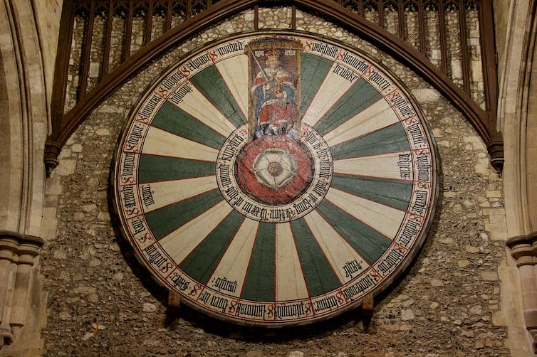 The Winchester Round Table, showing Henry VII sitting in Arthur's seat and with a Tudor Rose at its centre.