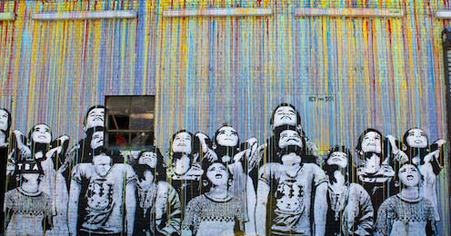 A graphic of schoolchildren painted on a wall.