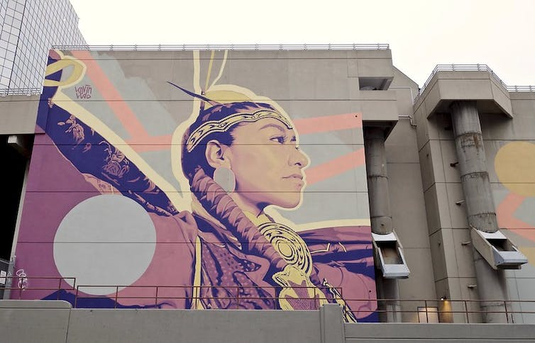 A mural showing an Indigenous woman.