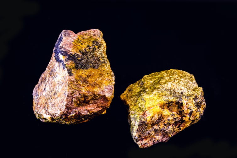 Two pieces of uranium mineral.