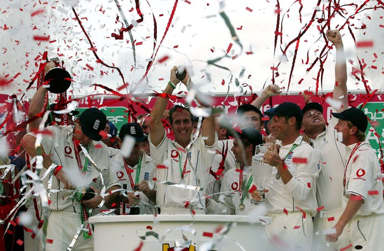 England men's cricket team with captain Michael Vaughan at the centre holding up the Ashes trophy after winning the series against Australia for the first time since 1985.