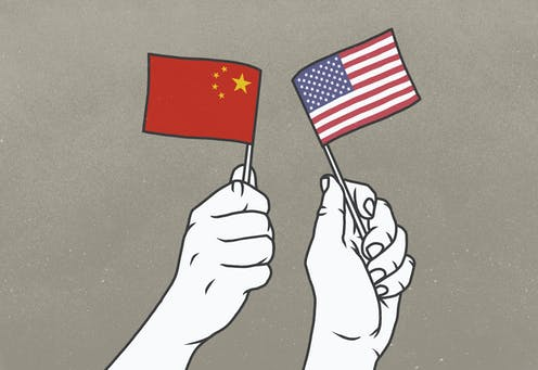 Drawing of two hands, one waving a tiny Chinese flag and the other waving a tiny American flag
