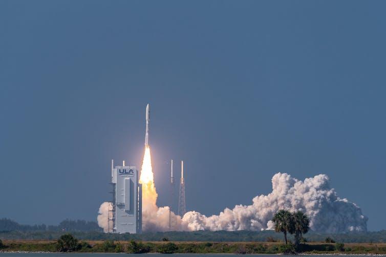 An Atlas-V rocket lifting off the launch pad.