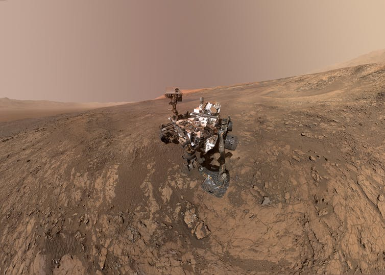 NASA's Curiosity Mars rover on Vera Rubin Ridge, with Mt Sharp in the background.