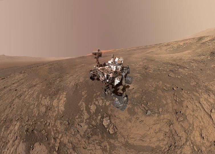 NASA's Curiosity Mars rover on Vera Rubin Ridge, with Mt Sharp in the background.