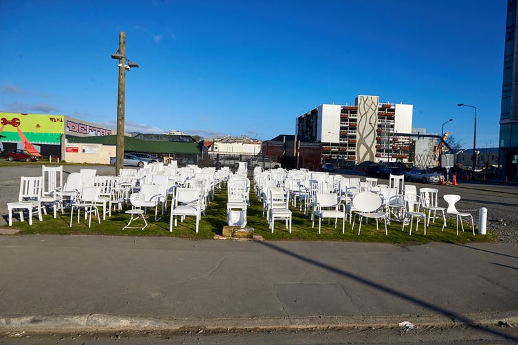 Empty white chairs in an abandoned city square