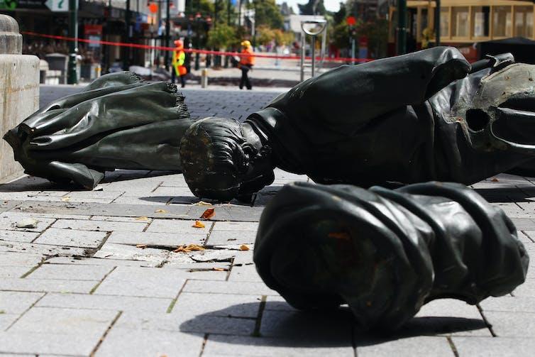 broken statue on the ground