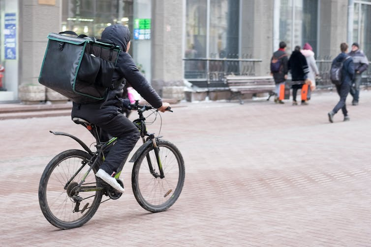 Cyclist with food delivery bag