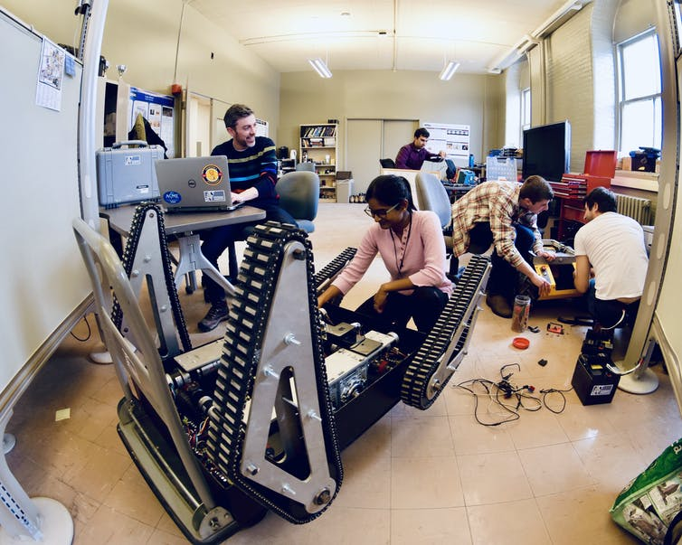 students in a robotics lab