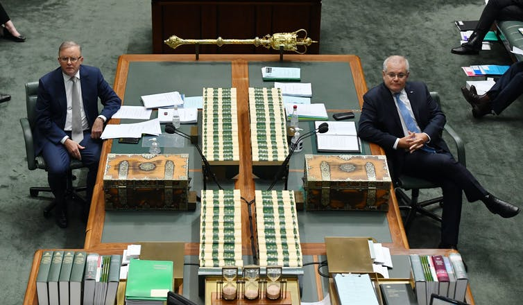 Labor leader Anthony Albanese and Prime Minister Scott Morrison look towards the Speaker's chair in Parliament.