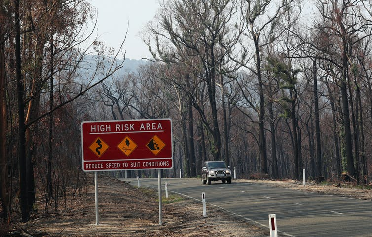 road sign warning of high fire risk in a burnt-out area