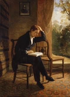 Painting of a young John Keats reading a book.