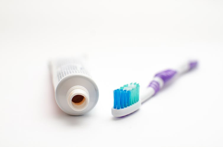 A tube of toothpaste and a toothbrush