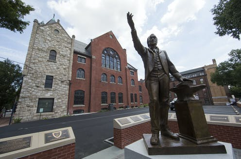 A sculpture depicting Bishop Richard Allen stands in front of Mother Bethel African Methodist Episcopal Church in Philadelphia.