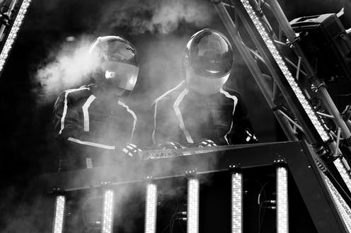 Daft Punk mixing on stage, black and white photo.