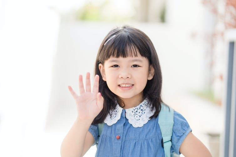 Little girl waving