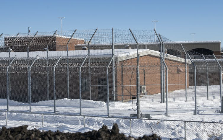 Saint-Jerome prison with barbed wire in front of the building