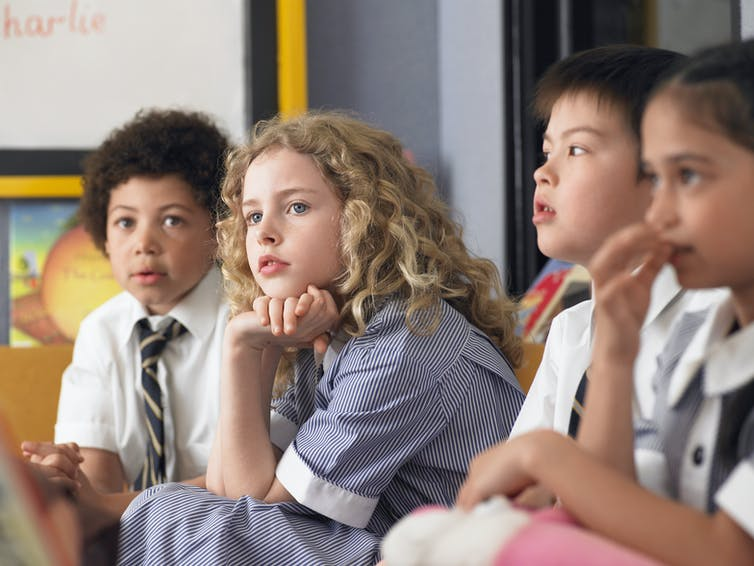 thoughtful young schoolchildren in class