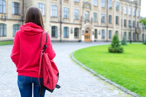 New student walks up to university buildings