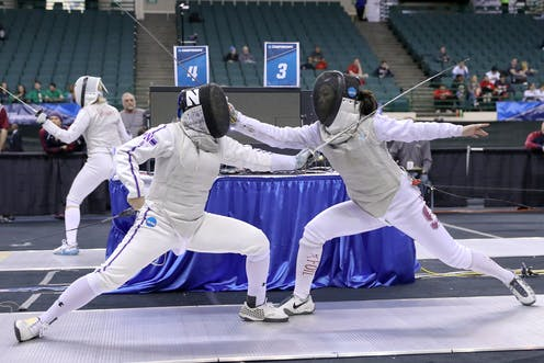 University fencers compete in a sports arena