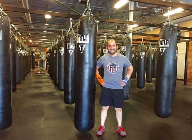 The author standing in front of punching bags.