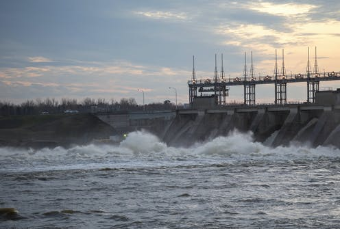 A hydroelectric dam with rushing water at the base