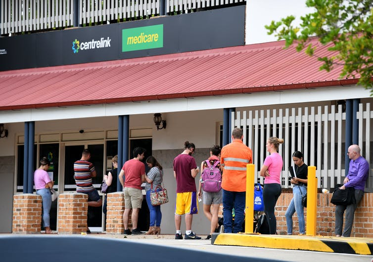 People queue outside a Centrelink office in Brisbane in 2020.