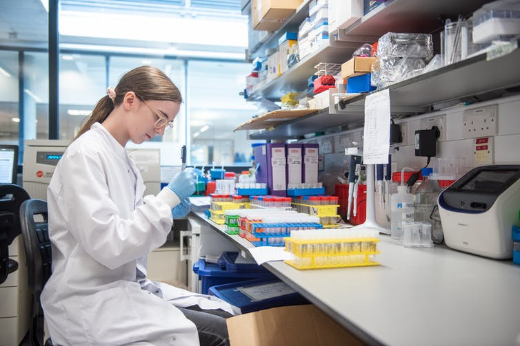 A scientist in a lab working on the development of the Oxford/AstraZeneca vaccine