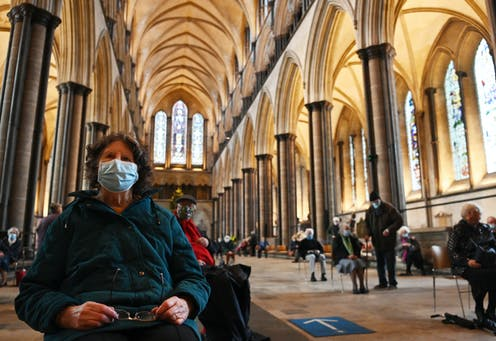 A woman waiting for a COVID-19 vaccination in Salisbury cathedral, UK