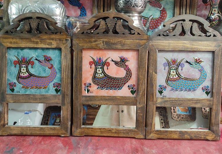 Şahmeran on a wooden frame in Mardin