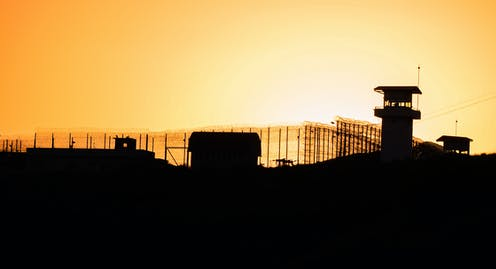 Silhouette of jail at sunset