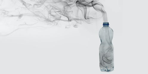 Smoking rising out of a plastic bottle