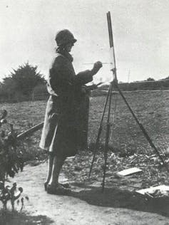 Old photo of woman outdoors