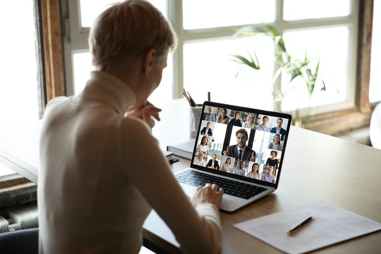 Woman on multiperson video call