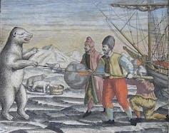 A polar bear lunges at men near a ship frozen in ice