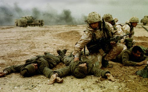 Infantry Soldiers of the British 4th Armoured Brigade in combat in Iraq, February 1991.