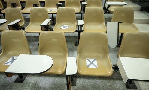 University chairs, some marked with x's.