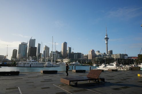 Auckland city skyline with harbour and tall buildings
