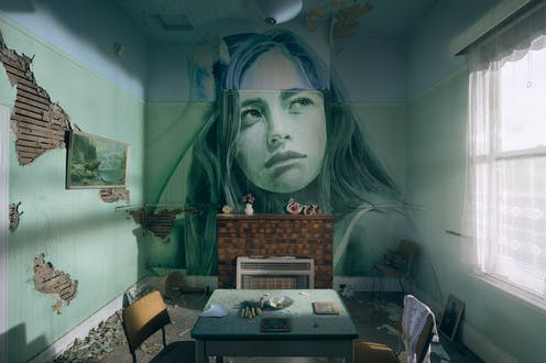 Painting of girl on wall of old room
