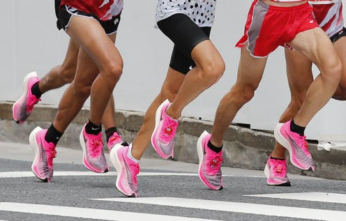 A shot of runners legs wearing the same pink running trainer