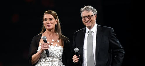 Melinda and Bill Gates, holding microphones