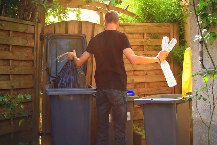 Man puts items in bins