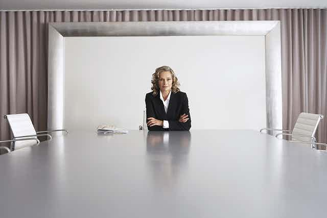 Woman at head of boardroom table