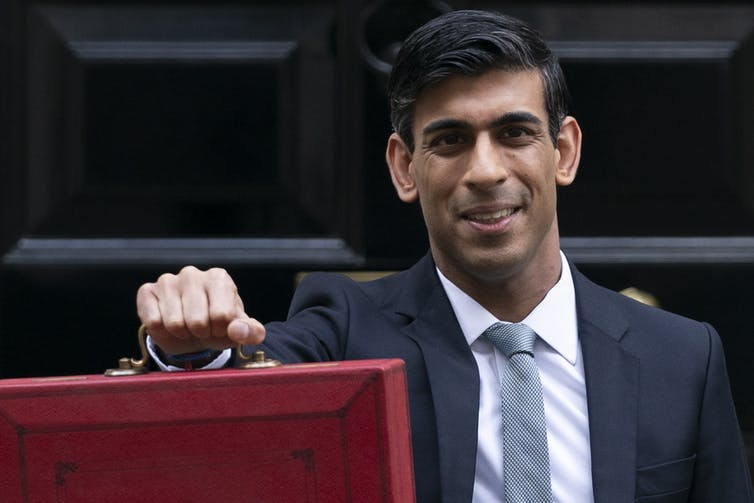 Rishi Sunak carrying large red briefcase outside Downing Street